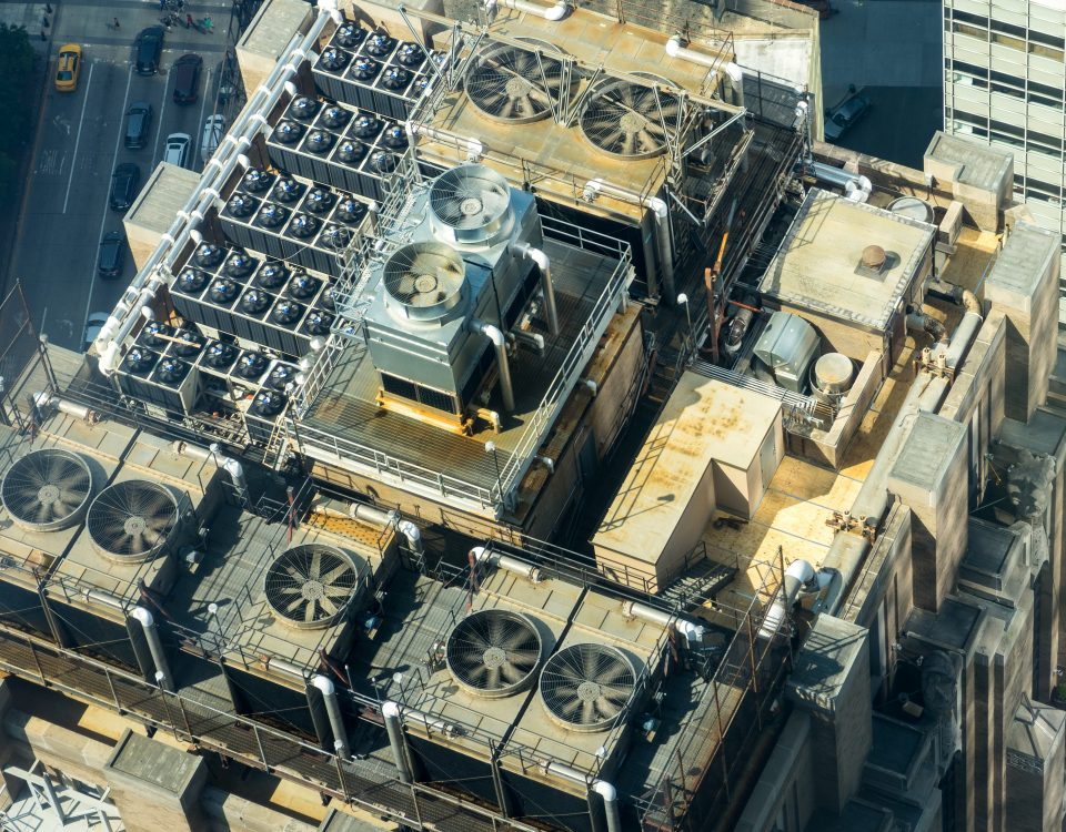 Cooling towers and why we love them | cooling towers on a rooftop in large city